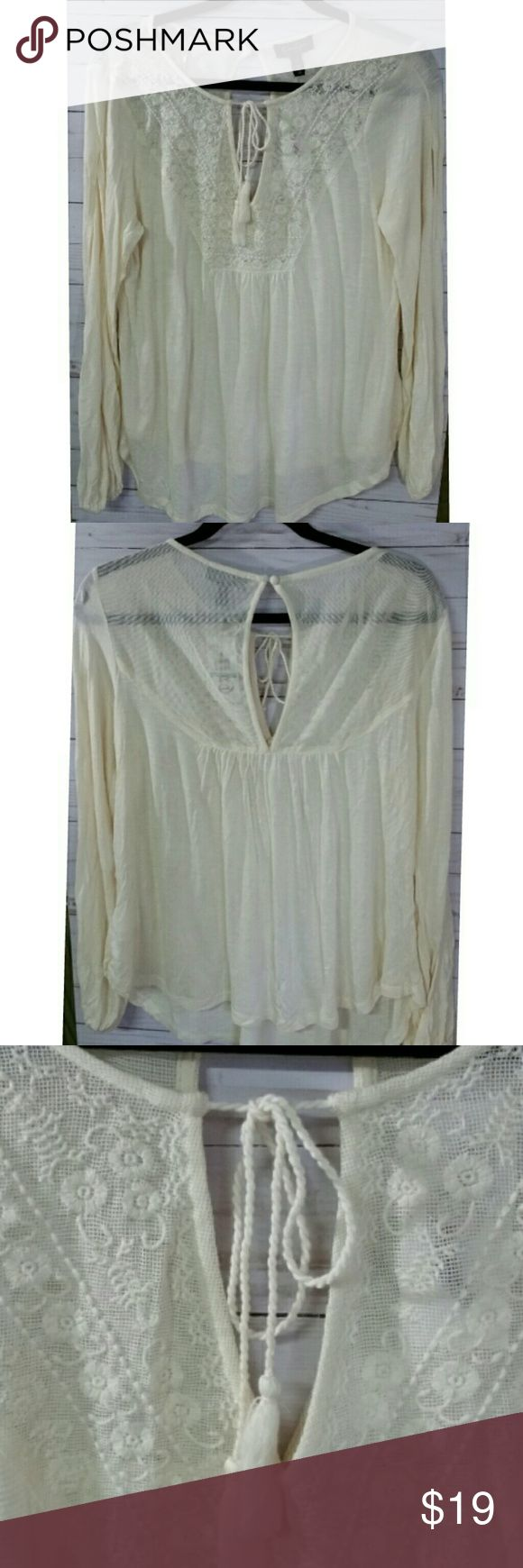 Jessica Simpson cream long sleeve  top Sheer cream material on bottom, Lace like at top Tie at front of neck, keyhole at back 28 shoulder to.hem in front/ 24 back 18.pit to pit 24 sleeve, from shoulder to wris All measurements are approximate   I offer a bundle discount check out my other listings   Thanks for looking! Tops