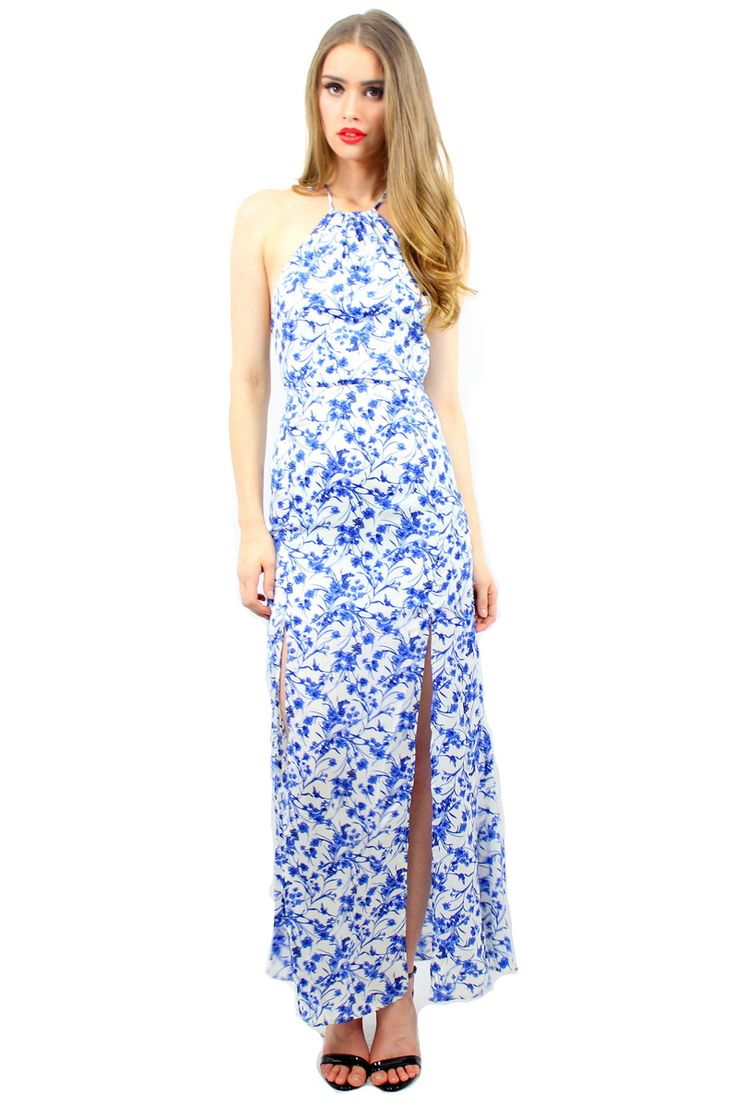 LONI MAXI DRESS NAVY  STYLE DETAILS:  Floral print maxi dress Halter style neck line Racerback with drawstring Structured around the waist Flowy skirt with two slits up front  FIT DETAILS:  Snug fit around waist, buy a size-up Hidden zipper Standard Australian sizing  STYLING:  Wear this blue boho dress on a beach walk or to a garden party, it's perfect no matter where you go!