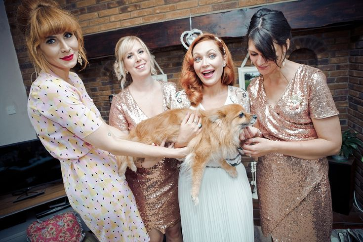 The bride included her beloved pet dog in her special day. Images by  Joel Smith Photography