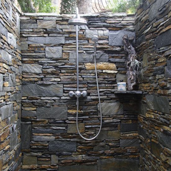 Outdoor shower with rock walls