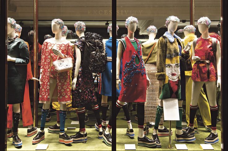 A group of Prada looks explore the theme of excess, opulent surfaces and encrusted accessories included.   - HarpersBAZAAR.com