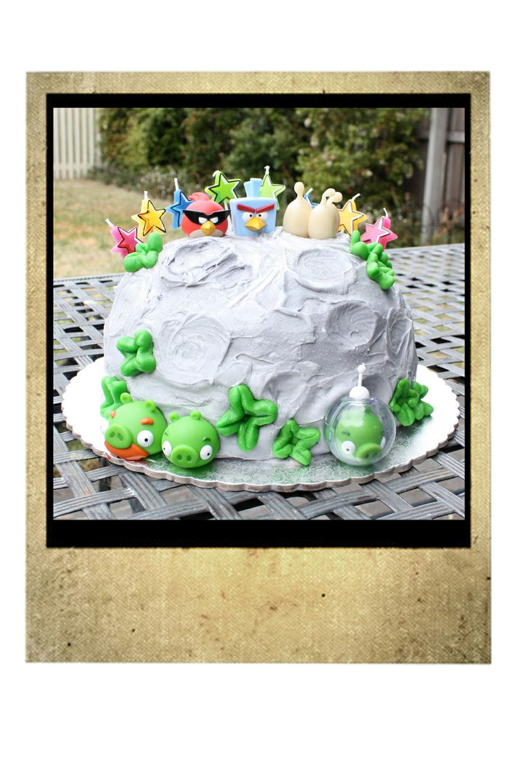 G's 8th Birthday Angry Birds Space Cake.  Rainbow coloured butter cake layers, sandwiched with alternating chocolate frosting and cheesecake.  Grey tinted frosting sprinkled with silver edible glitter and decorated with ABS figures, marzipan flowers and space eggs.