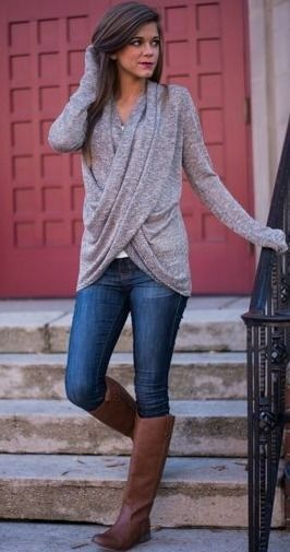 Fall fashion, grey sweater, denim jeans, high camel boots.