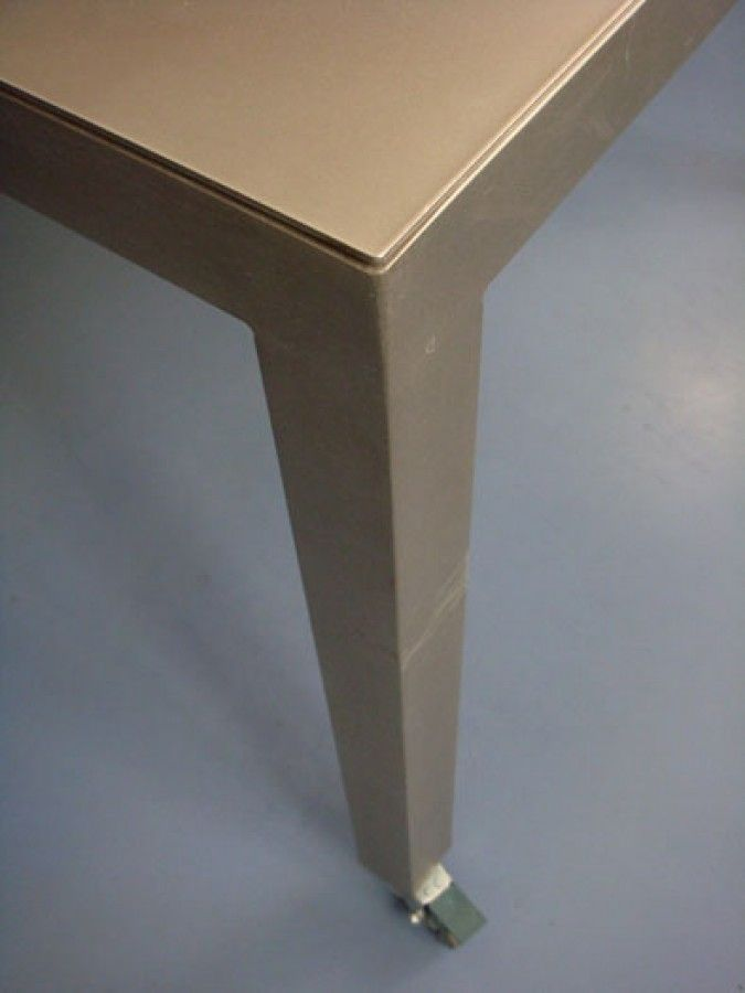 Office meeting table. Shot-peened stainless steel top and legs with 75mm diameter wheels