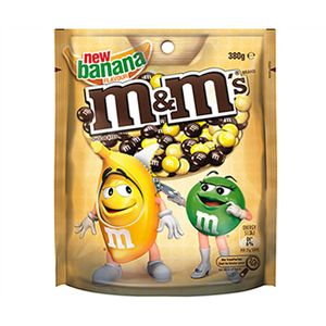 A box of 12 packs of M&Ms Banana Bags. Banana flavoured chocolate in a thin crisp shell.
