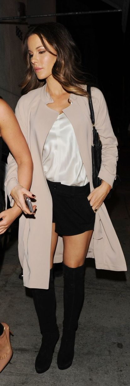 Who made  Kate Beckinsale's black handbag, thigh high boots, and tan coat?