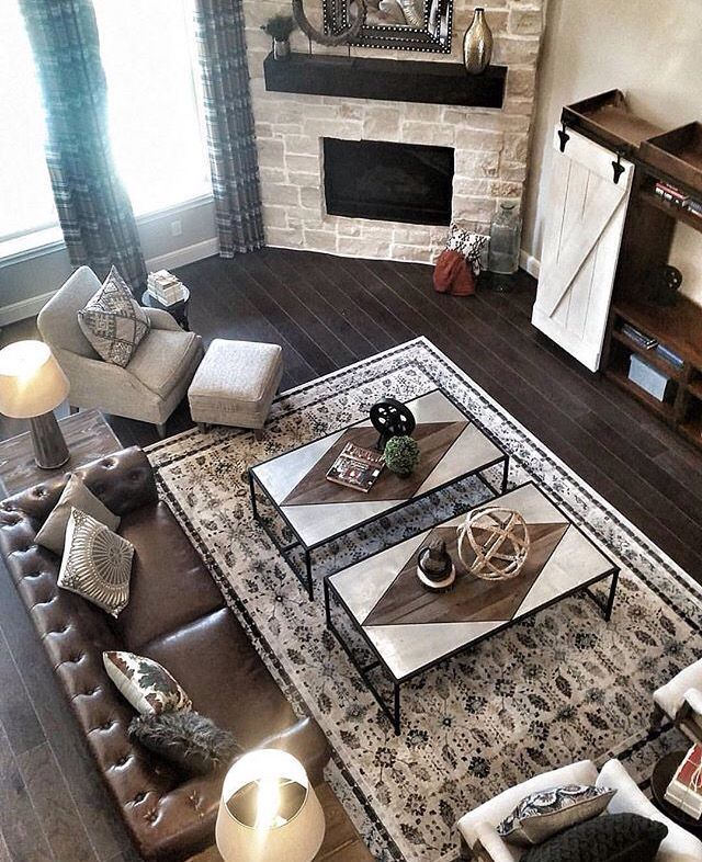 Love the idea of a corner fireplace. And I love those floors and the stone they…