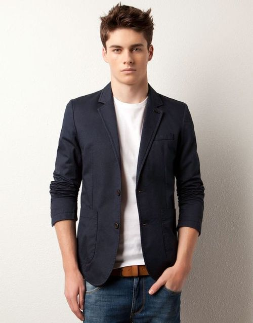 Team a navy blazer with blue jeans if you're going for a neat, stylish look.  Shop this look for $71:  http://lookastic.com/men/looks/white-crew-neck-t-shirt-blue-jeans-brown-belt-navy-blazer/4240  — White Crew-neck T-shirt  — Blue Jeans  — Brown Leather Belt  — Navy Blazer