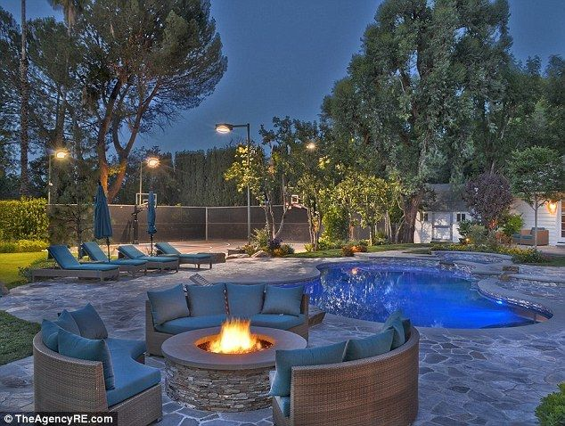 Party pad: According to the realtor, 'the newly built downstairs Media room has a bar which opens to the outdoor BBQ and fire pit lounge are...