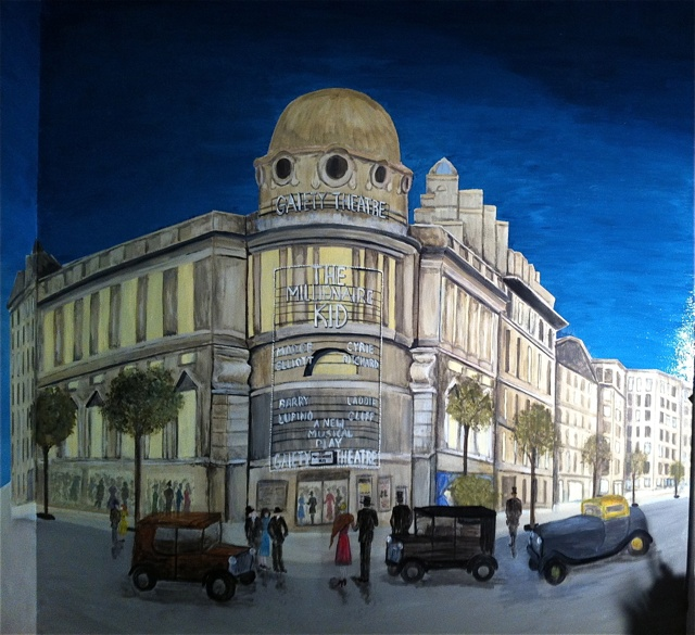 I was asked to paint a scene from London  in the Theater District with night time activity.  Client chose Gaiety Theatre 1931. Prospective was difficult as we could only back up about 4 ft. from the painting (outside his home theater).