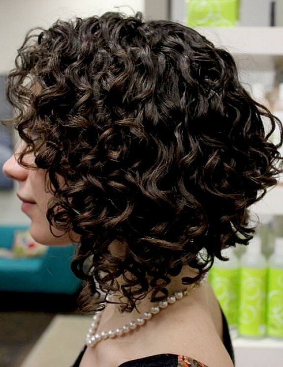 Cute long angled bob hairstyles with thick curly hair and dark brown hair color for modern women