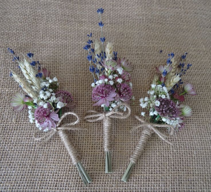 Ladies wedding corsages of wheat, lavender, gypsophila and astrantia, bound with brown string.