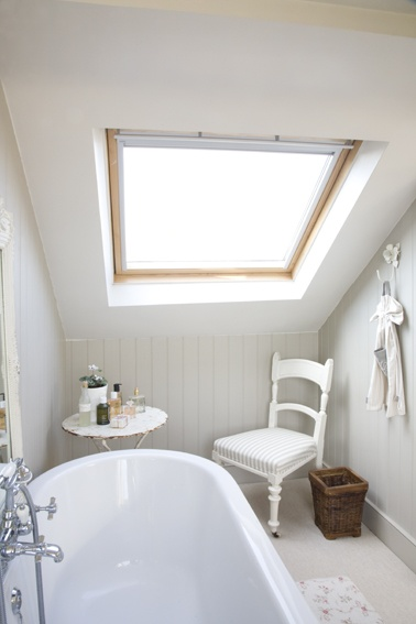 Roll top bath and wall cladding