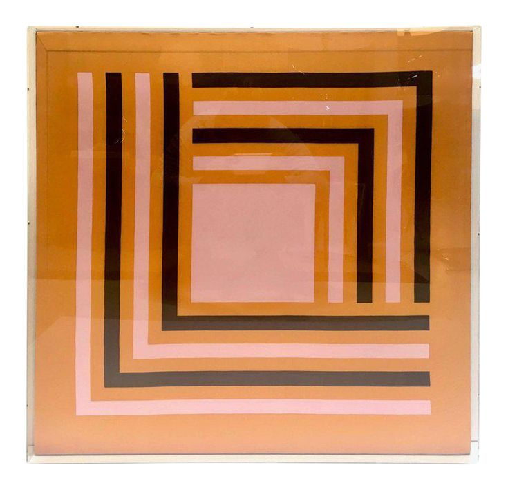 A great hard edge graphic abstract vintage silk scarf, circa 1970s. The scarfs design of interlocking lines and a square, reminiscent of Albers, circa 1970s has vivid contrasting colors of orange, pink and deep chocolate brown. The scarf is artfully arranged in a chic and simple modernist design custom mounted in a Lucite plexiglass frame.