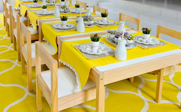 Easter setting: Tables and chairs, yellow table runners, false grass and rug - all Ikea