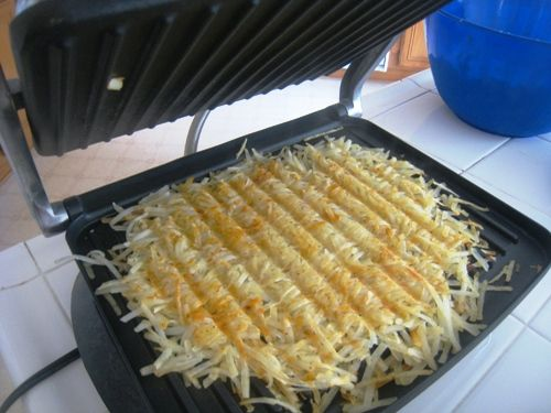 panini press hashbrowns- I did this with my George Foreman, and it worked like a charm. Sooo much easier than babysitting them in a pan...