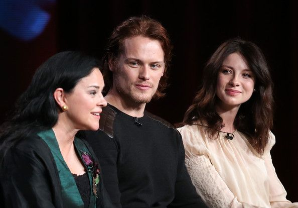 Sam Heughan (L-R) Author Diana Gabaldon, actors Sam Heughan and Caitriona Balfe speak onstage during the 'Outlander' panel discussion at the...