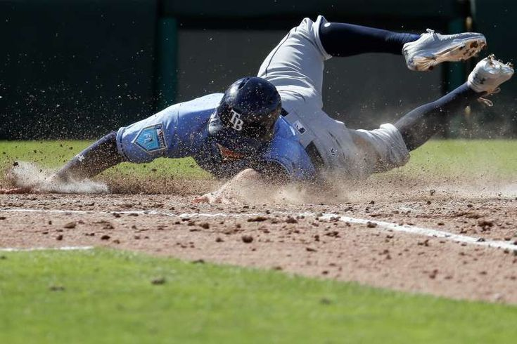 2018 MLB spring training  - DIRTY JOB Johnny Field of the Tampa Bay Rays scores against the Minnesota Twins on Feb. 25 in Fort Myers, Fla. Minnesota won 5-4.