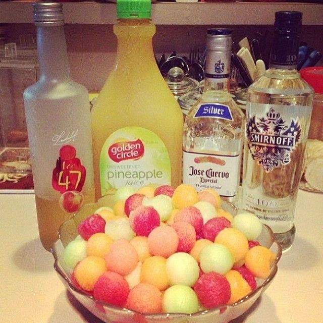 Drunken Melon Balls :) ~Frisky    Watermelon  Cantaloupe  Honeydew melon  Vodka  Pineapple Juice  Peach Schnapps  Tequila (opt)  Use a melon ball scoop to fill your bowl with melon balls. Pour your liquor and juice over the balls and refrigerate. http://www.tipsybartender.com/page/24