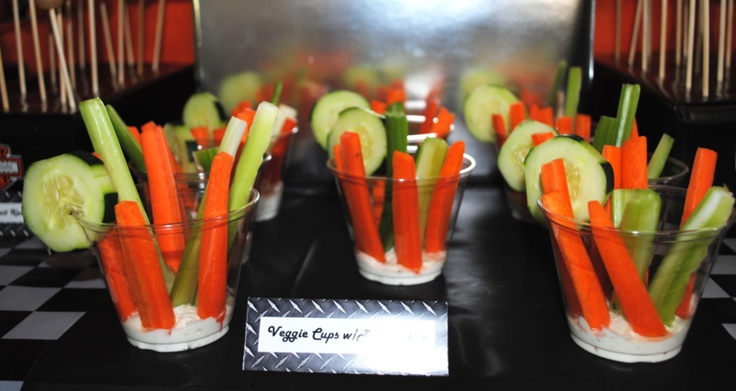 Veggie cups with ranch dip in small plastic solo cups