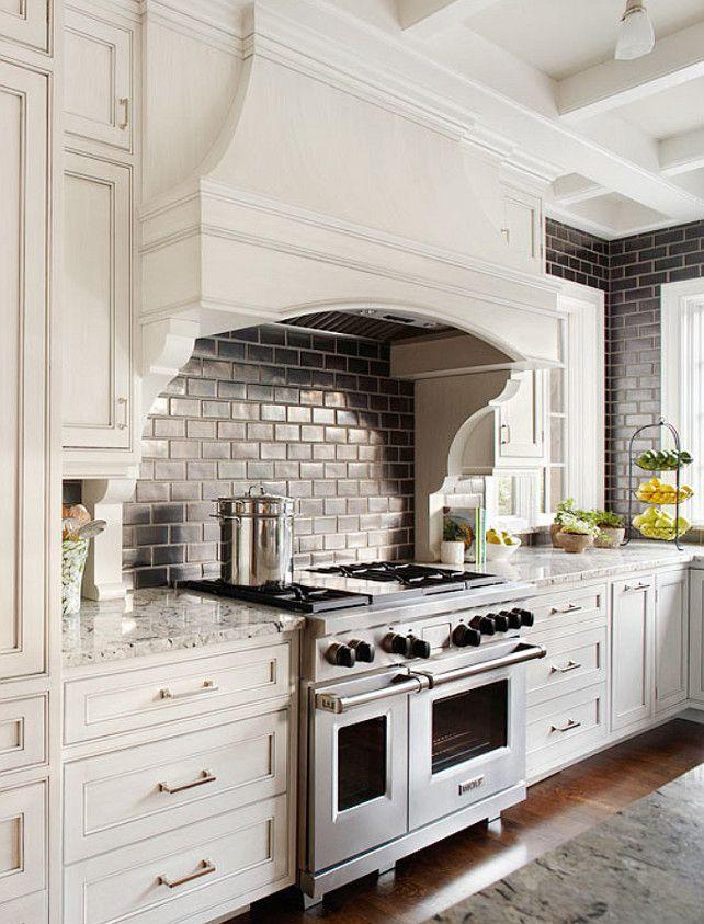 Black Subway Tile On Full Kitchen Backsplash Over White Granite Countertops