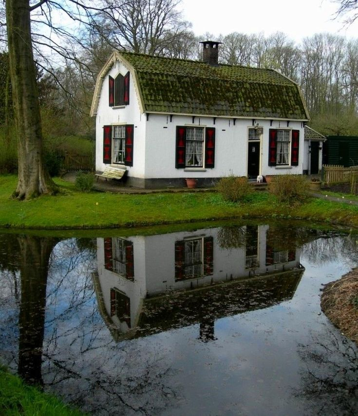 Reflections of a cottage in Loenen, Netherlands