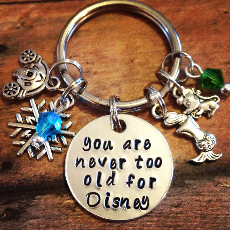 You are never too old for Disney keychain with charms-little mermaid-cinderella-princess-snowflake-snowqueen by TrendsByHeni on Etsy https://www.etsy.com/listing/225390006/you-are-never-too-old-for-disney