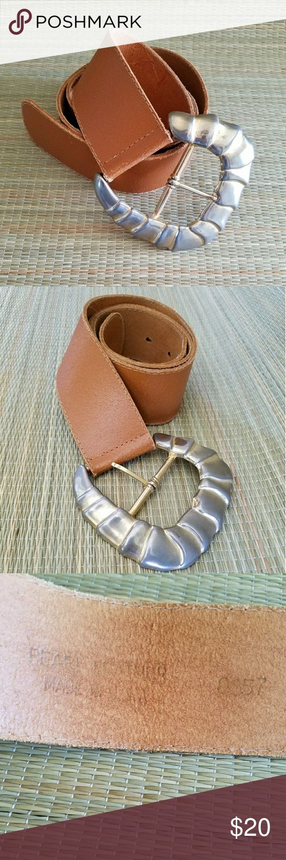 """Vtg 87 Pearl Tan Leather Slant Buckle Belt Tan leather belt with slanted gold tone buckle. Buckle has wear due to age. Three pre punched holes and adjusts from 29"""" to 31"""". MADE OF Genuine Leather Buckle measures 3.5"""" x 3"""" Pearl Accessories Belts"""