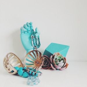 Turquoise and silver vignette with succulents
