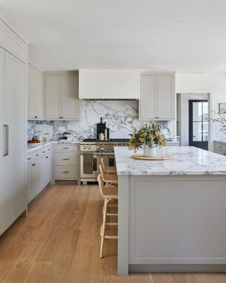 Stunning greige colored cabinets in this incredible ...