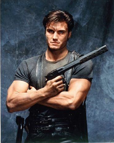 Dolph Lundgren as The Punisher. Yes, that is a suppressed Desert Eagle.