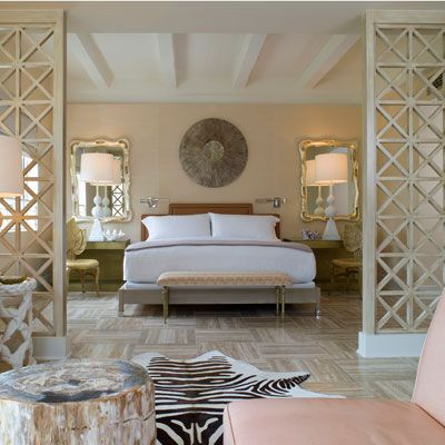 Bedroom Decoration Ideas - Decorating a Master Bedroom - Good Housekeeping - Modern Glamour - Desks beside bed with chairs and mirrors.