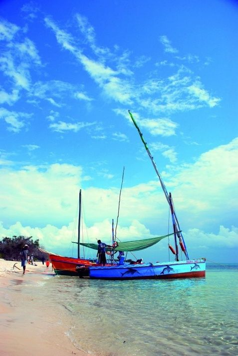 Fishing boats along the shore at Praia do Tofo ~ Mozambique  Where to Stay can accommodate you in Tofo Beach. Click on link to see our listings. http://wheretostay.co.za/moz/in/accommodation/tofo-beach.php
