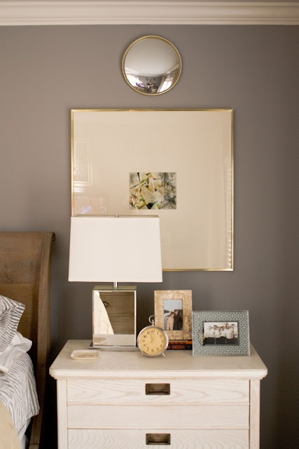 love the reflective surface on the lamp in a square shape, the art with oversized matting and the simple decor on the white table