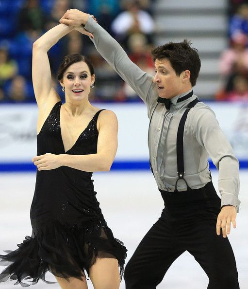 Tessa Virtue and Scott Moir of Canada skate during the ice dance short program at  2013 Skate Canada,  Ice Dancing dress inspiration for Sk8 Gr8 Designs.