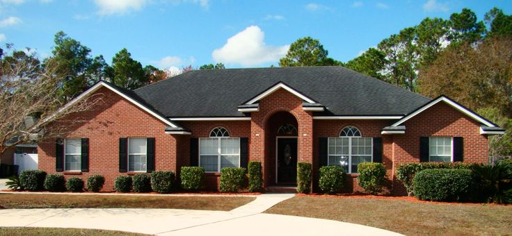 All brick home on approx 12 acre lot with circle