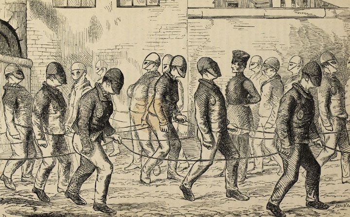 Convicts exercising at Pentonville Prison from Henry Mayhew's, 'The Criminal Prisons of London', 1862. Every prisoner had a cell to himself, But the prison regime, known as the 'separate system'involved depriving a prisoner of all human contact; shutting him up in his cell except for brief exercise periods, masking his face, and forbidding him to speak.