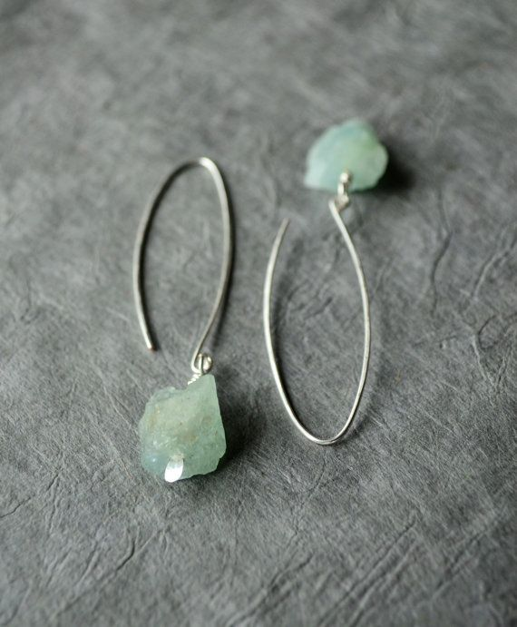 This minimalist pair of earrings features two rough, raw genuine aquamarine nuggets (unpolished), set on silver plated paddle pins and dangling from long, handmade elongated sterling silver ear wires. | inBeads of Santiago, Chile, via Etsy.