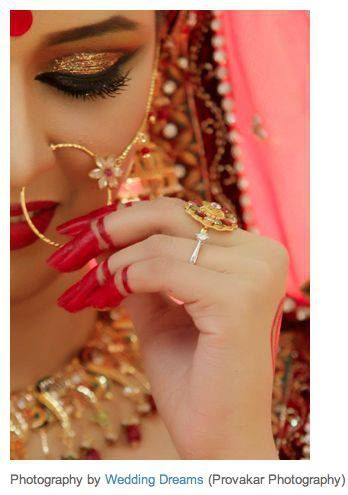 Indian bride. Loving her nose ring jewelry with the flower.
