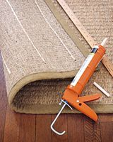 How to make Slip Proof Rugs~ A tube of acrylic-latex caulk. Apply it to the back side of your rug about every 6 inches. Let dry & flip it over & it should be slip free.