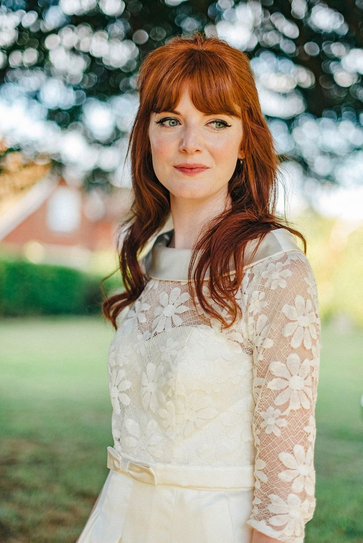 Bride Amy wears a replica 1960s wedding dress, designed by Fur Coat No Knickers of London, for her quirky and kitsch wedding. her hair in a simple and modern take on a half up half down 1960s bouffant. Photography by Jacqui McSweeney.