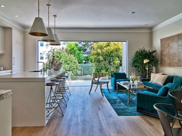 Contemporary Great Room with Hardwood floors, Dupont - corian designer white, Michael graves - klismos chair, Standard height Alternate layout - table to sie, living area on through route to outside