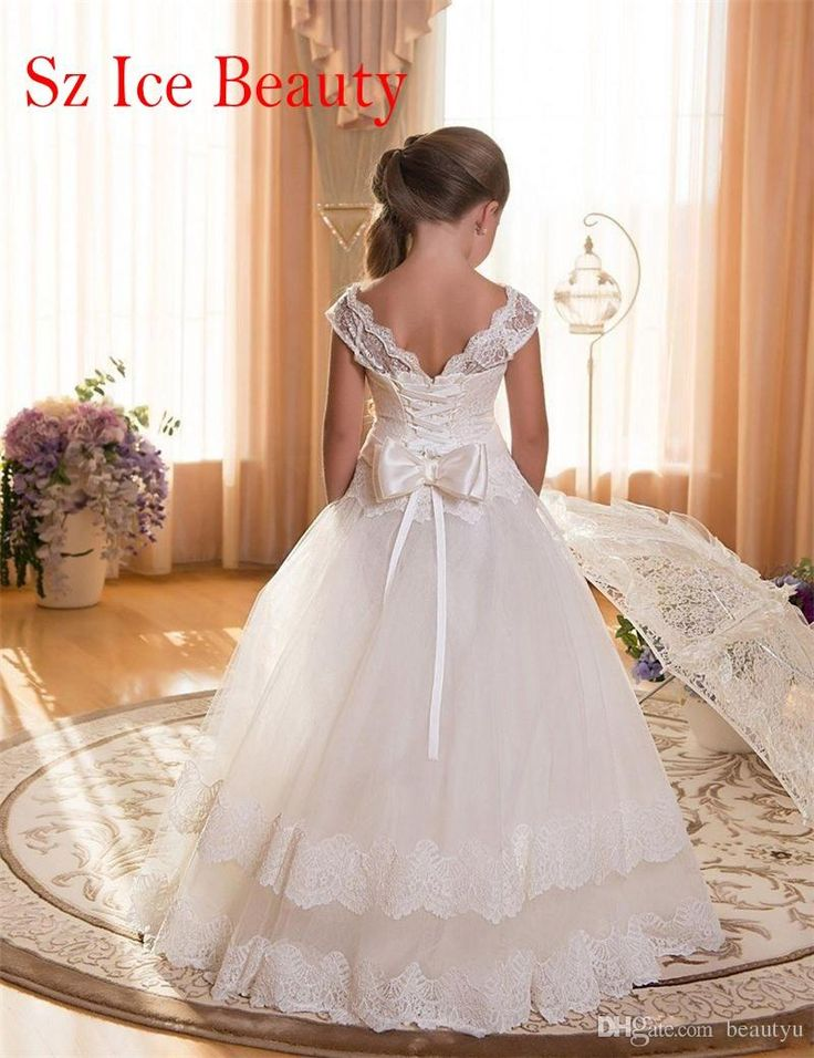 The girls special occasion dresses which match the flowers- 2016 white floor length flower girl dresses for weddings cap sleeves lace tulle kids first communion dress 2016 cheap puffy prom dress is offered in beautyu and on DHgate.com girls white dress along with ivory bridal shoes are on sale, too.