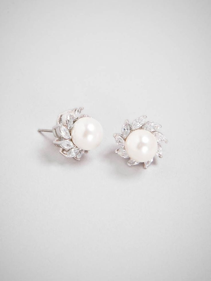 There's not much we think is missing from a chic pair of simple pearl studs, except for maybe a healthy cluster of marquise crystals.