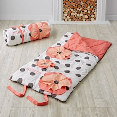 Sometimes you just want sleep in a flowerbed. At least we did. So we designed this floral sleeping bag. It's perfect for adding a touch of chic to your sleepover. The grey and white polka dot design gives it a sophisticated look, while the bright, vibrant flowers add a playful pop of color. Personalize it with your child's name for an extra special touch.