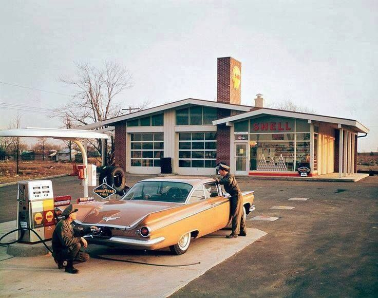 Love this shot. Classic Shell station architecture, classic car. Wish I could get service like this today.