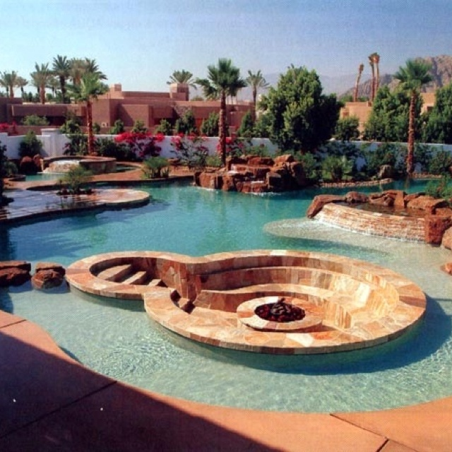 Fire pit in the pool. and for those who don't want to get wet can socialize with those in pool