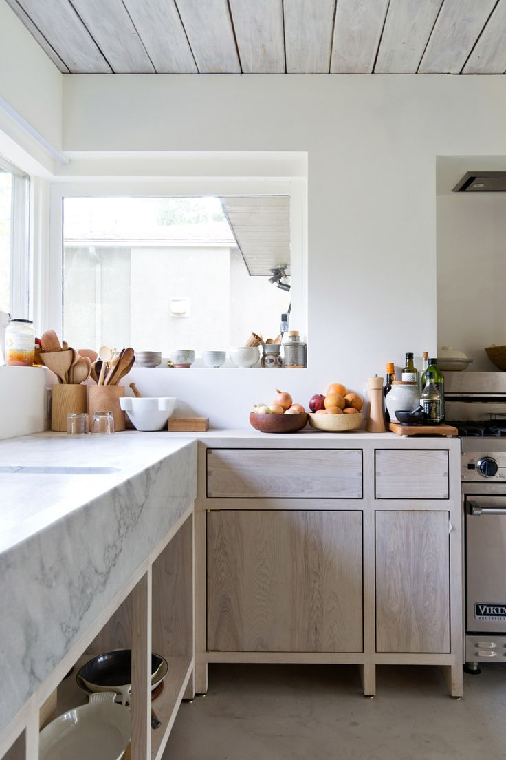 Canadian studio Scott & Scott added simple wooden surfaces, white-washed walls and a marble sink to the interior of a mid-century property north of Vancouver.