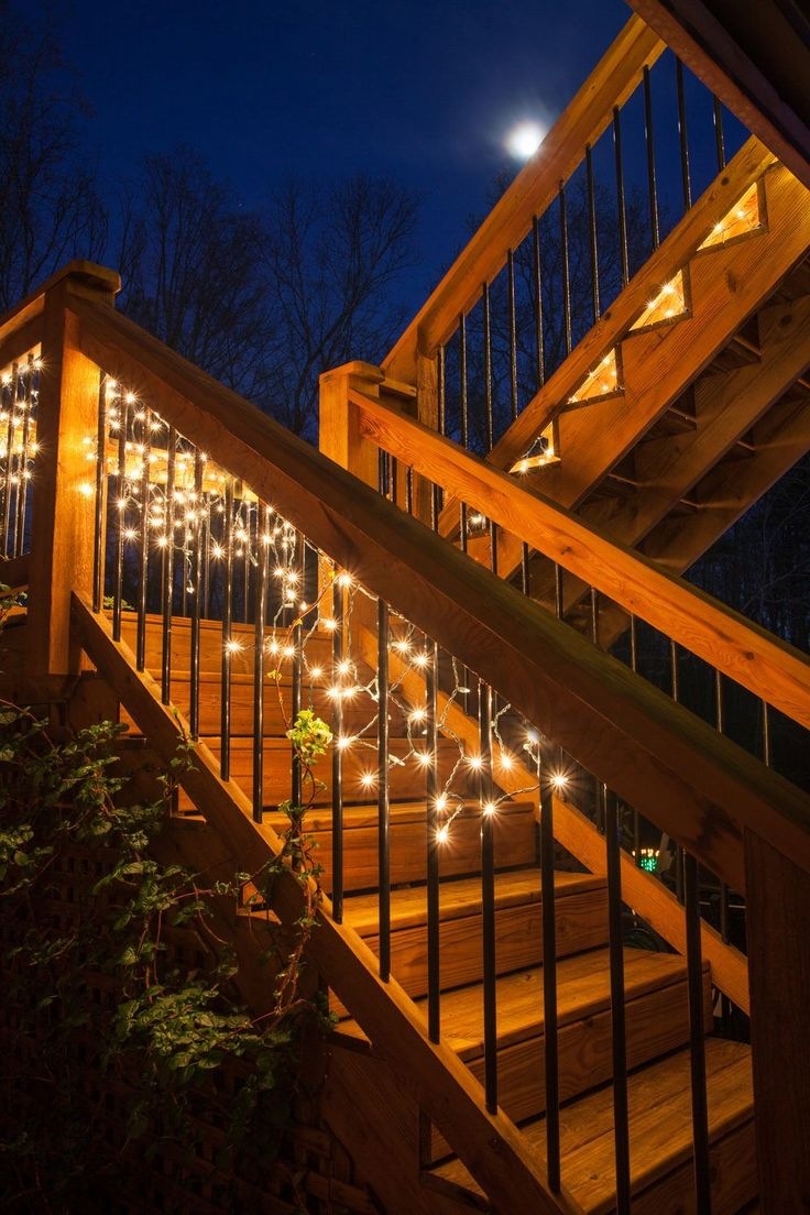 Here is a deck lighting idea for inspiration - hang white lights along stairs and railings for parties and elegant soirees