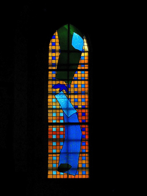 Brian Clarke - blue nun and green -  small window at east end behind choir stall